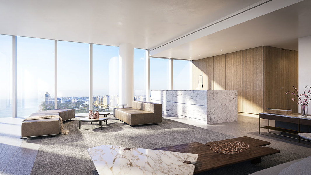A stark, streamlined space at 2000 Ocean in Hallandale Beach, Florida, becomes cozier with earth tone