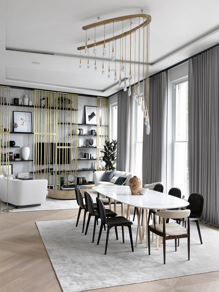 Shades of grey, black, and mixed metals create a layered look in this living room designed by Dara Hu