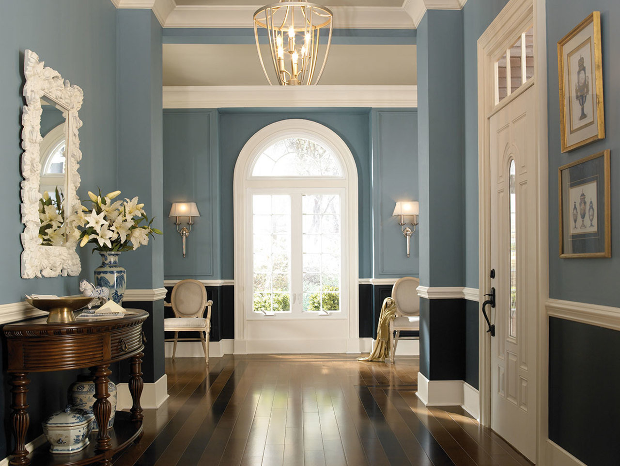 A tone-toned foyer is anchored by a darker hue closer to the floor.