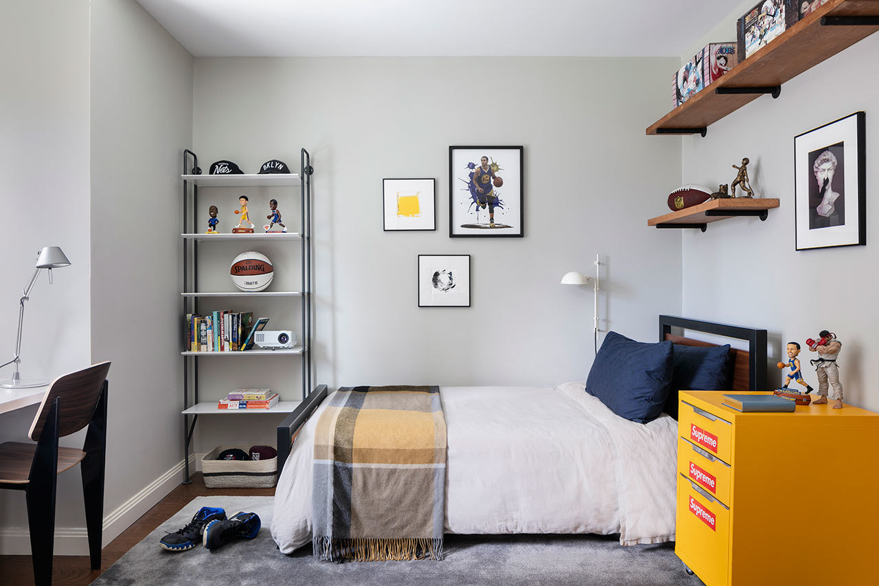 In a bedroom designed by Revamp Interior Design, sports take center stage, but in a grownup way.
