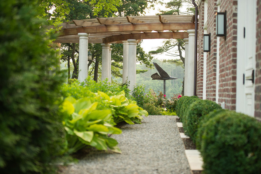 A lush garden space—with pergola—designed by Janice Parker.