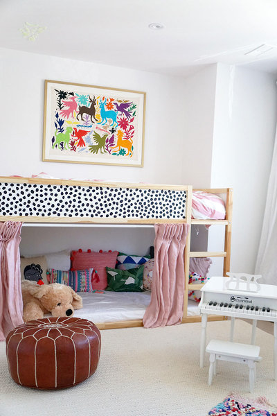 A combined playroom/ bedroom designed by Quinn Cooper comes to life thanks to modern artwork, a color