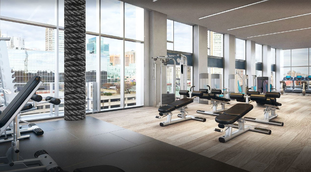 Soaring double-height windows lend light and an open feel to this airy gym designed by Kari Whitman.
