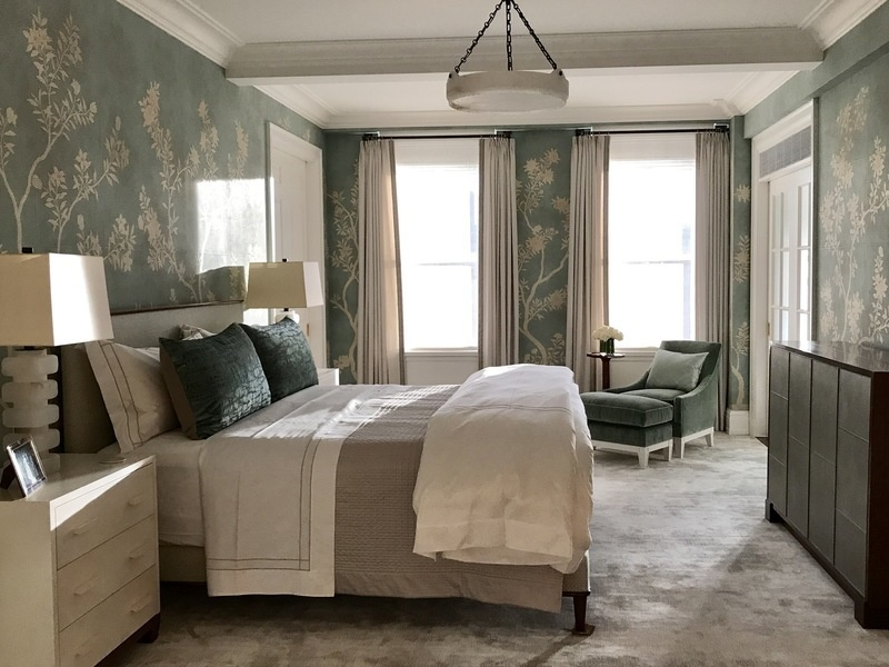 Floral wallpaper lends an air of elegance to this bedroom designed by Erica Millar.