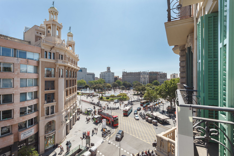 Balcony view from an apartment located in the historic and famous Plaça Catalunya. The three-bedroom,
